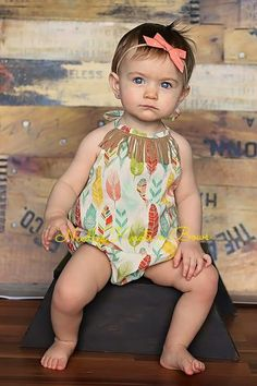 Our new feather print romper with suede fringe around the front, ties around her neck like a halter top and has elastic in the back.  This little romper will be very comfortable therefore you will have a happy baby beings they would love nothing better ...