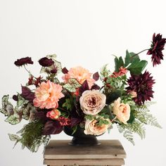 Make your own statement centerpiece with faux flowers from Afloral.com.