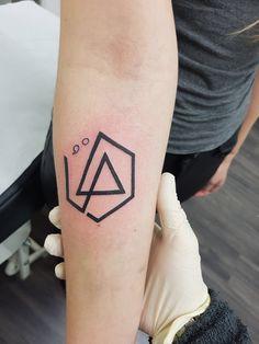 Linkin park symbol tattoo on forearm