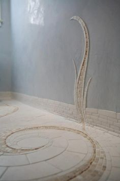 About half a meter mosaic from floor, then a few stretches in shapes of plants or small trees, or just beutiful swirls. On the wall opposite to the toilet and next to the door.