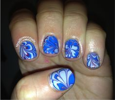 Dry water marble nail art.  Blues.