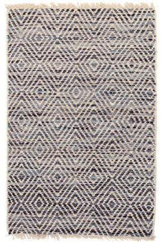 A diamond pattern in shades of Indigo, denim, and French blue contrasts with natural jute yarns, creating a dazzling effect on this rustic-look woven jute area rug.