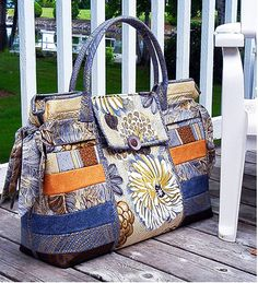 """A really BIG BAG !! With lots of pockets. Two pockets on the outside and 6 on the inside. Size: 22"""" wide x 18"""" tall and 6"""" deep. Uses 1 yard x 58"""" - Bosal Single-Sided Fusible Foam Stabalizer"""