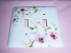 Roses steel double lightswitch cover - swarovski crystals. $15.00, via Etsy.