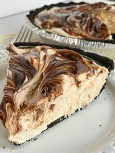 No-bake peanut butter fudge swirl pie if loaded with peanut butter, fudge, and cream cheese inside an easy Oreo cookie crust. So easy to make and the best no bake dessert you will ever eat. If you love peanut butter & chocolate then this pie will become a favorite.