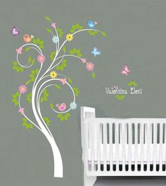 Kids swirl tree vinyl wall decal with birds flowers butterfly and Childs name letters cute for any nursery. $85.00, via Etsy.