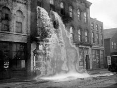 Whiskey being dumped from a distillery at the beginning of Prohibition | 20 Photos From The Days Of Prohibition