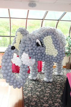 Balloon Sculptures - Elephant Balloon Sculpture - party decor idea - Entering the ballroom, our light up, colorful balloon sculptures are guaranteed to enliven your guest's eyes. They are designed to create a unique experience for your party guests. Elephant Balloon, Balloon Animals, Baby Shower Advice, Shower Ideas, Elephant Birthday, Balloon Decorations, Balloon Ideas, Event Decor, Event Ideas