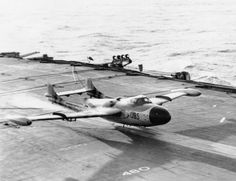 A flak-damaged De Havilland Sea Venom ) of 893 Squadron, landing safely without undercarriage on HMS EAGLE Military Jets, Military Aircraft, British Aircraft Carrier, De Havilland Vampire, Royal Navy Aircraft Carriers, War Jet, Aircraft Design, Ww2 Aircraft, Fighter Jets