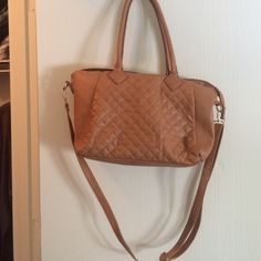 Tan fake leather purse I love this so much but can't use it anymore with the job I have. Can be used cross body or by the handles. Zipper works and has plenty of storage inside. No stains from pens or anything. Only used for six months. Handles have some damage but not noticeable unless close up. Rue 21 Bags