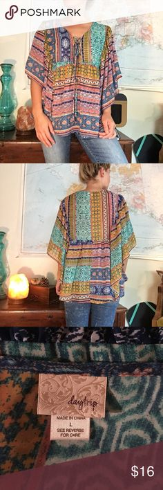 Boho Batwing Daytrip Top This cute boho top is sheer however it has a few layers so no need to layer a tank. The front has a little cross cross design on the neckline. Daytrip Tops