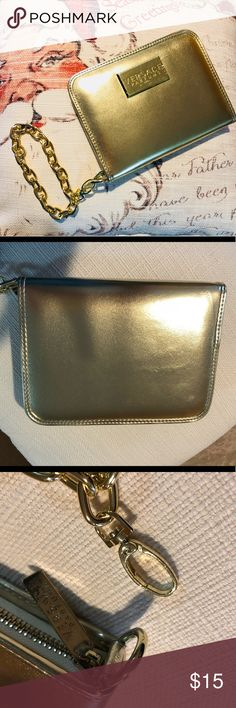 NWOT - VERSACE Gold Wristlet (perfume collection) New without tags, perfect new condition, hardware still protected.  From Versace Perfume Collection, Gold Wristlet with detachable chain, and zipper closure, interior features ID and credit card sleeves, buttoned cel pocket, zipped coin pocket and pen holder. Offers welcome! Versace Bags Clutches & Wristlets