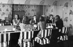 What fun! 1940s girls doing their hair in a darling salon/dressing room.