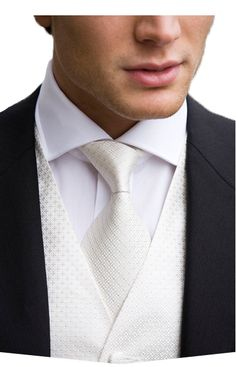 Groom attire. Might do all black on the groomsmen and do white vest or silver vest on Johnathan