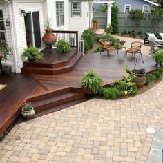 A Patio Deck Design will add beauty to your home. Creating a patio deck design is an investment that will […] Backyard Patio Designs, Backyard Landscaping, Low Deck Designs, Stone Patio Designs, Paved Backyard Ideas, Small Front Yard Landscaping, Landscaping Design, Hardwood Decking, Cozy Backyard