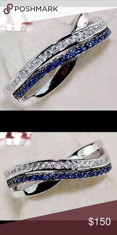 Solid SS ring with Blue sapphire & White Topaz Gorgeous!!! 925 Solid genuine Sterling Silver crossover ring with Blue sapphire and white topaz it's just beautiful 925 Jewelry Rings