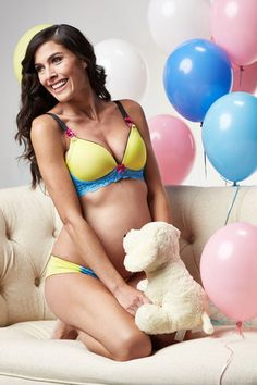 Zoe is romantic and cheerful. Beautifully constructed maternity and nursing bras feature full molded yellow color cups, baby blue shimmer lace bands embellished with the brand's signature splash of hot pink color throughout – cup lining, nursing clips, and decorative bows. This fun & attractive t-shirt nursing bra provides both function and everyday comfort. Lined with our signature hot pink 100% cotton for breathable comfort.