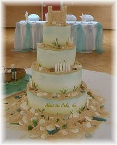 like the sand and seaglass and shells on this beachy cake w/ sandcastle on top