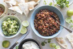 Healthy beef nachos with fresh avocado salsa