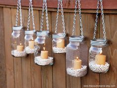Hanging mason jar garden lights with DIY lids!  Gorgeous for outdoor wedding or parties!
