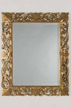 A beautiful gold leaf Baroque style frame from France c. 1875 enclosing the original beveled mirror glass. (35 1/2″w x 43 1/2″h)