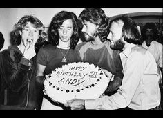 THE BEE GEE'S, MUSIC GROUP OF THE LATE 70'S, EARLY 80'S......:) Andy Gibb eats a cherry from his birthday cake at a party given by his family in his home in Miami Beach, Fla., Monday night, March 6, 1979. Andy's brothers, the Bee Gees, from left are, Robin, Barry and Maurice. (AP Photo)  NOW ROBIN GIBB FIGHTS FOR HIS LIFE AGAINST CANCER......:/