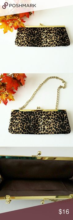 Animal Print Fabric Clutch w/Chain Handle Perfect for date night, girl's night out or club hopping! Use as a clutch or pull out the hidden gold tone chain handle; your choice. Brown interior w/one small pocket to secure ID and/or cash stash! EUC. Measures approx. 10in wide and approx 4in. tall  *Ask Questions B4 U Buy!*#poshmark #poshstyle #poshmarkseller #shopmycloset #buymystuff #newstuff #fashionforless #shop #lowprices #hautecouture #quickship #newfashion #fashion #suggesteduser #shoes…