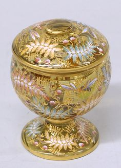 A Moser footed covered marigold jar with enameled Moser leaves, Czechoslovakia, circa 1885