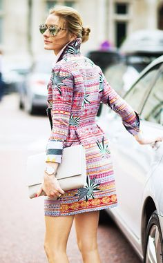 Olivia Palermo in a patterned coat dress, mirrored sunglasses, and envelope clutch