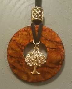 Washer pendant with alcohol ink. Finished with a charm and cording. #JewelryDisplays