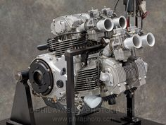 """Second version of the 1000cc V4 """"Bi-Pantah"""". Circa 1982. This final version of the SOHC 2 valve per cylinder desmo had very oversquare 78 x 52mm bore/stroke dimensions and weighed 98kg. It used oil & air cooling. Benched tested at 105hp @ 9,500rpm in touring tune with mufflers, it made 132hp @ 11,000rpm with slight tuning. Photographed in the Engine Test Dept. at the Factory, June 2007."""