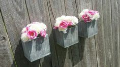 Our set of 3 rustic wood planter boxes are the perfect pieces for your home. (Flowers not included)  These boxes measure approximately 6.5