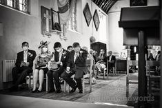 Black and white documentary wedding photograph of groom's party wearing covid protection face masks in church wedding ceremony. Photo by one thousand words eddign photography. Grooms Party, Church Wedding Ceremony, Documentary, Party Wear, Face Masks, Photographs, Photo Wall, Black And White, Photograph