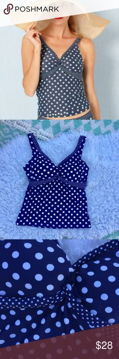 """Boden Polka Dot Twist Front Tankini Boden twist front tankini swim top. Colors are navy blue and white. Molded cups built in. (Model photo slightly different color scheme.) measurements (flat) - bust - 30"""", waist - 26"""", length (armpit to hem) - 12"""". PLEASE NOTE : these measurements do not account for the stretch of the Swimsuit. 💫 Smoke free home. Offers are welcome! No trades, please. Bundle multiple items for a discount and only pay for shipping once! Boden Swim Bikinis"""