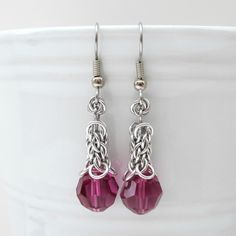 Beautiful fuchsia Swarovski crystals adorn these Candy Cane Cord chainmaille earrings. Small silver aluminum jump rings were hand woven to create the small section of the CCC weave. A stainless steel