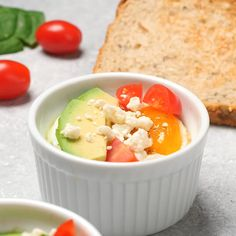 Baked Eggs With Spinach Topped With Avocado, Tomatoes, And Crumbled Feta Cheese Makes A Great Breakfast For Every Day Or Easy Entertaining. Egg Recipes For Breakfast, Breakfast Bake, Easy Healthy Breakfast, Best Breakfast, Breakfast Casserole, Breakfast Ideas, Breakfast Spinach, Baked Eggs In Shell, Baked Egg Cups