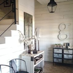 Farm foyer. A lot of little shoes are tucked away in that metal bin. #furniturewithfunction
