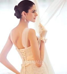 The strap can be optional. All over lace detail with beaded satin belt and dramatic mermaid skirt.