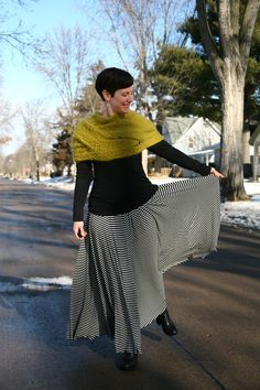 Capelet, black tee, striped maxi skirt, black boots