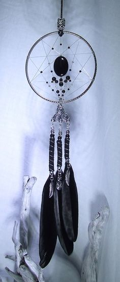 Check out this item in my Etsy shop https://www.etsy.com/uk/listing/269853696/black-dream-catcher-wall-hanging-onyx