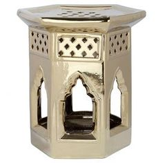 """Ceramic indoor/outdoor garden stool with a cut-out design.    Product: Garden stoolConstruction Material: CeramicColor: GoldFeatures: Indoor and outdoor Cut-out detail Dimensions: 17.5"""" H x 16"""" W x 16"""" D"""