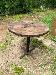 Repurposed cable spool table with cast iron base