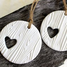 "white clay tag, wooden pattern, heart cut out and on reverse - "" A Very Special Day with Heather & Chris 01.07.16"""