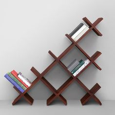 Watch Out For This Distinctive Book Shelf That Fits On Your Wall And Keeps Your Books Segregated And Visible. The Irregular Shape Gives This Furniture A Modish Look And Multi-shelves Assure Numerous Books At A Time.Use Of Handpicked Solid Wood Assures Its Long Lasting Structure. Expertly Created For Durability, This Is Not To Be Missed.