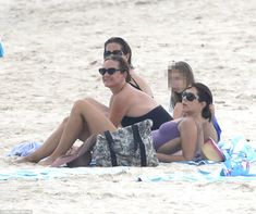 Beach queen: Crown Princess Mary kicks back on the sand in Byron Bay in northern NSW, Australia