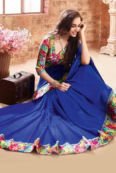 Add more glam to your party look with this gorgeous blue color printed saree adorned with digital print lace border. This georgette saree will give an eye-catch