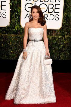Salma Hayek never disappoints with this classic clean gown updated with the metallic belt.  love!