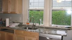 light maple cabinets white counters - Google Search