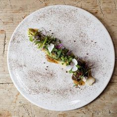 Smoked leek with goat cheese, walnuts and garden herbs   FOUR Magazine