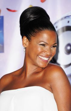 Chic Nia Long ...  Plush waist to hips ratio...   Long appears in the video for Kanye West's -Touch the Sky-